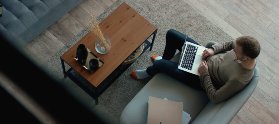 Man in living room on laptop